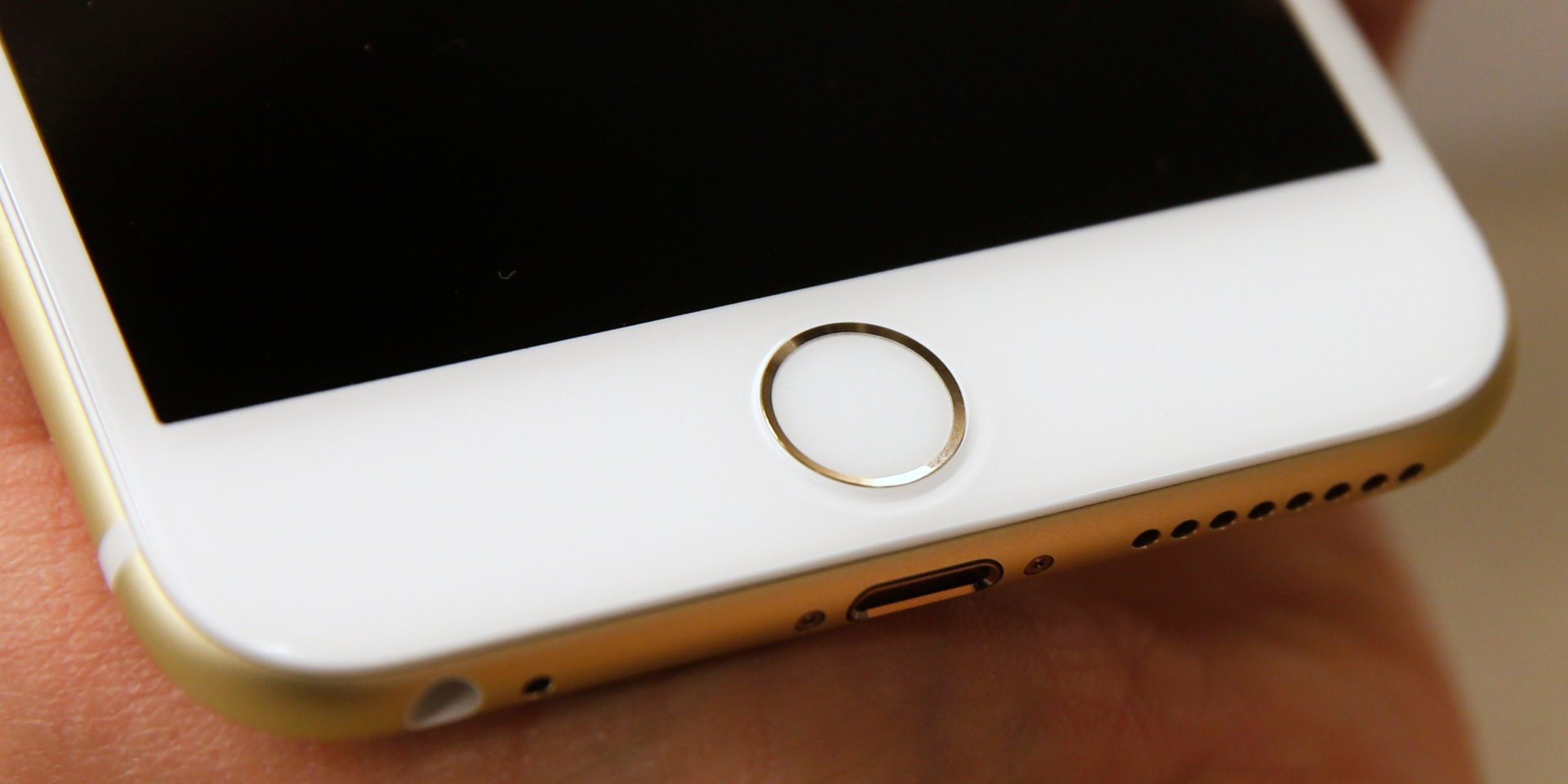 Apple is working on an iPhone with a fingerprint sensor behind the display, according to a new report — and it could arrive as soon as next year (AAPL)
