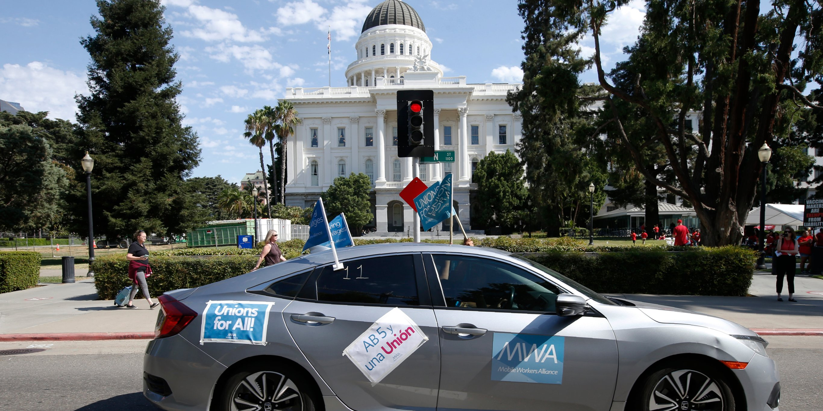 Uber, Lyft, and DoorDash are gearing up for a $90 million fight in California — here's why they oppose the state's new gig-worker bill and what they're proposing instead (UBER, LYFT)