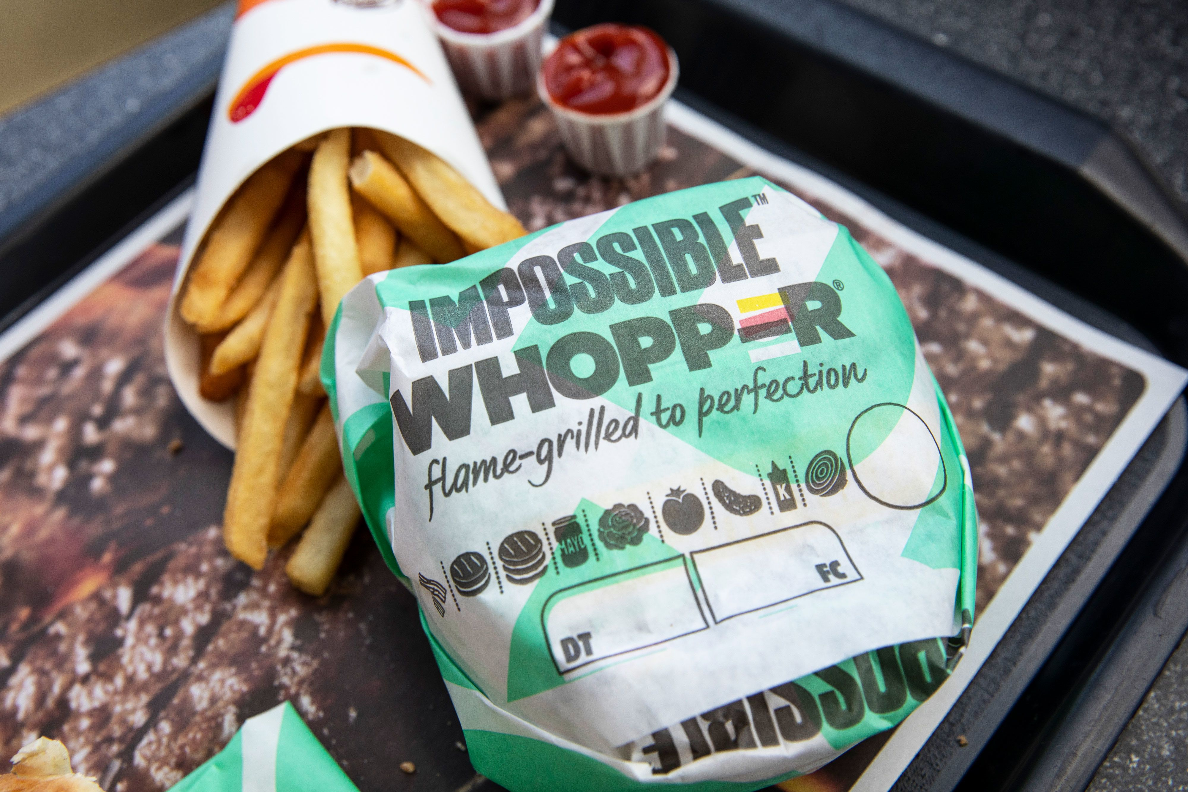 Burger King's parent company reports earnings in line with expectations