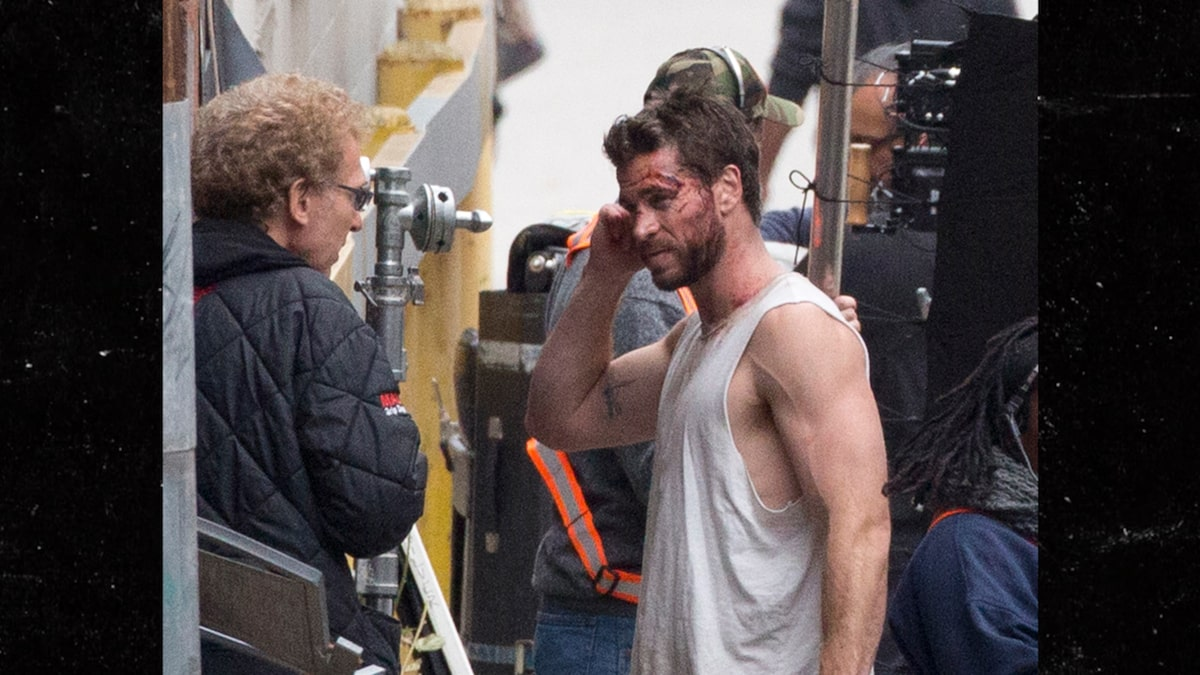 Liam Hemsworth Flaunts Huge Biceps as Miley Brags About New Guy's Abs