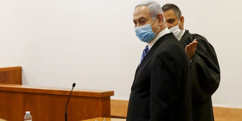 Netanyahu becomes the first Israeli prime minister to stand trial over corruption and fraud cases