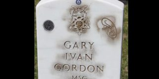 Police are investigating how the gravestone of Medal of Honor recipient Gary Gordon received these mysterious markings