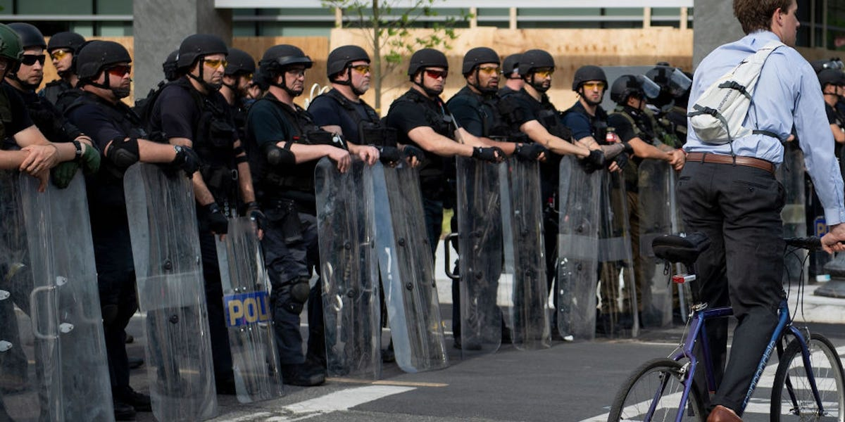 Heavily-armed men who refuse to identify themselves are patrolling the streets of Washington, D.C. They were sent by the Bureau of Prisons.
