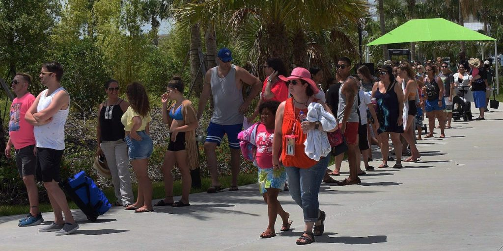 People wait in a queue to enter Island H2O Live! water park in the Orlando area over Memorial Day weekend.