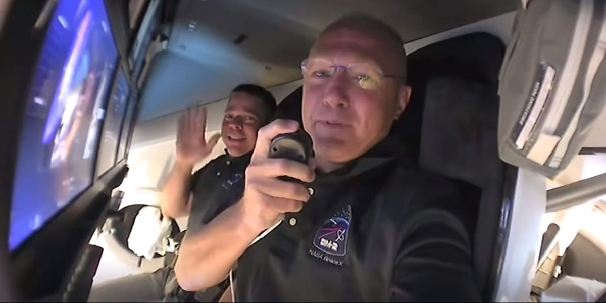 Watch 2 NASA astronauts try out SpaceX's new private spaceship for the first time in zero-gravity