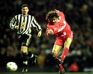 Patrik Berger of Liverpool shoots at goal as Gary Speed watches on.