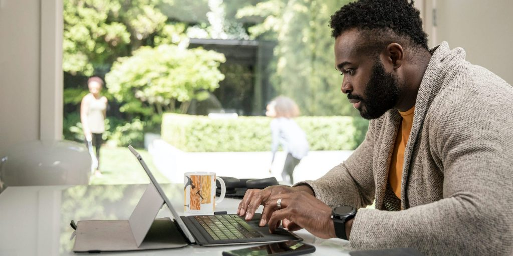 businessman using tablet and phone working from home