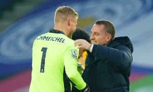 Brendan Rodgers goes to hug Kasper Schmeichel after the win against Wolves that took Leicester top