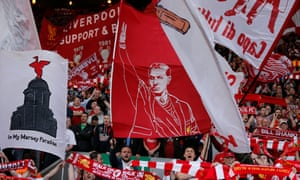 A flag showing Brendan Rodgers is waved on the Kop during Liverpool's defeat by Chelsea on 27 April 2014