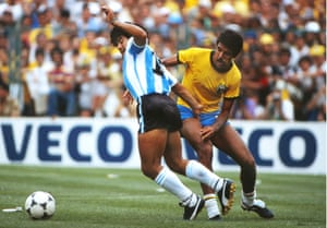Diego Maradona battles with Brazil's Toninho Cerezo during the 1982 World Cup