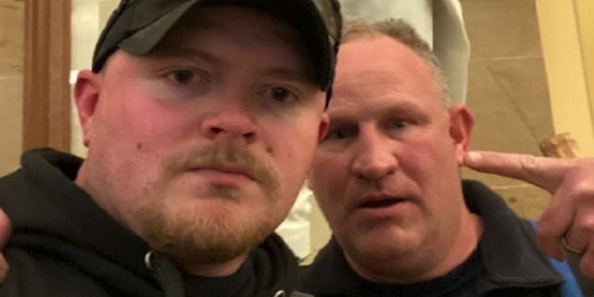 2 Virginia police officers were arrested after taking a selfie inside the Capitol during the insurrection