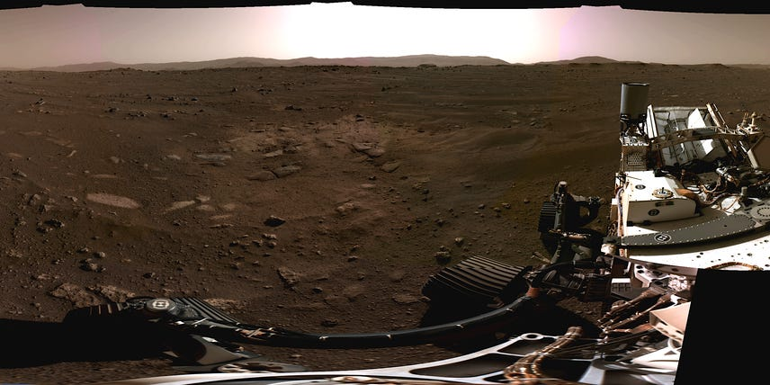 Stunning photos from NASA's new Mars rover reveal 200-foot cliffs, mysterious rocks, and a perfect touchdown