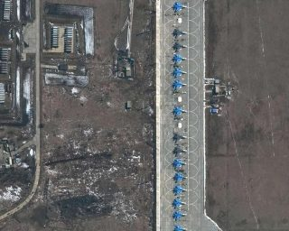 Photos show Russia's military buildup near Ukraine as Putin claims dominion over more of the region's sea and air