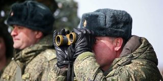 Russia suddenly says it's pulling back troops from Ukraine's borders after weeks of tensions and fears of an invasion
