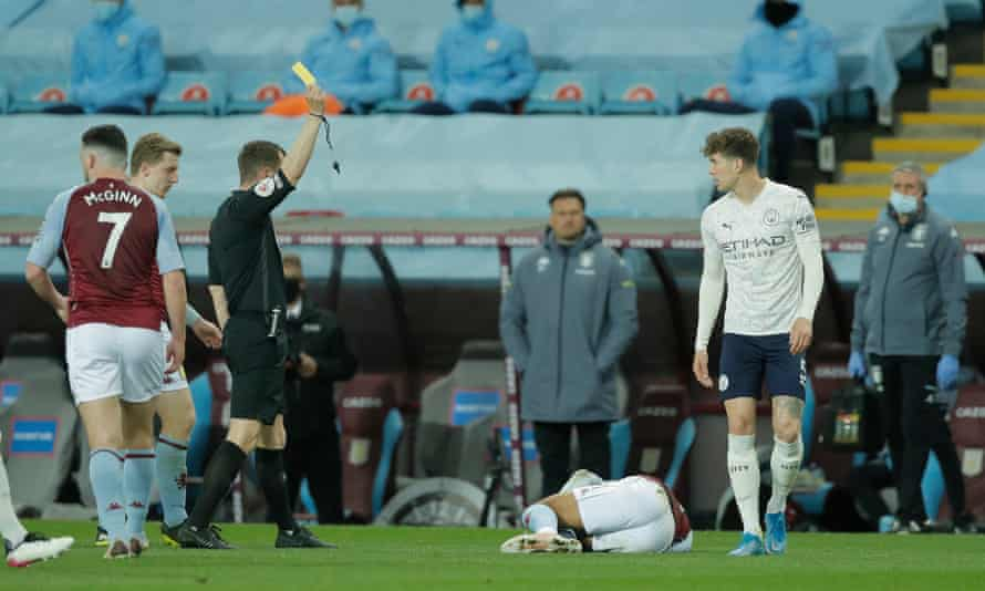 John Stones receives a yellow card before it was changed to a red